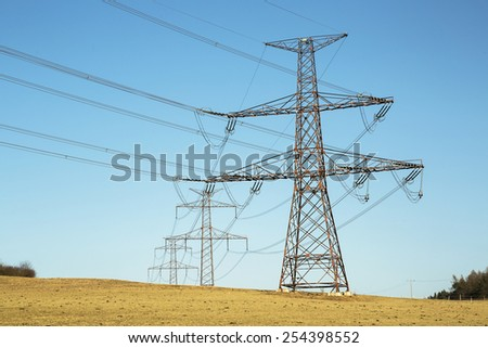 High voltage pylons, Power lines - stock photo