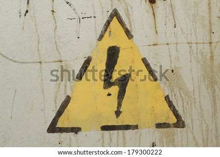 high voltage sign on a gray wall - stock photo