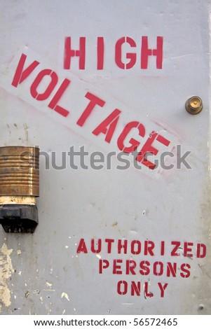 High voltage stenciled on door - stock photo