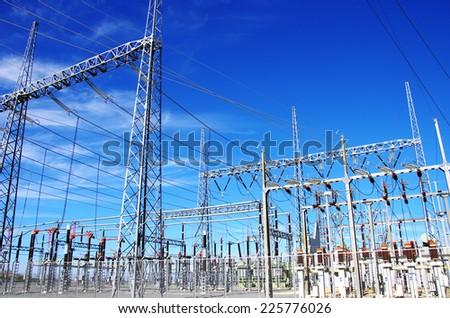 high-voltage substation on blue sky - stock photo