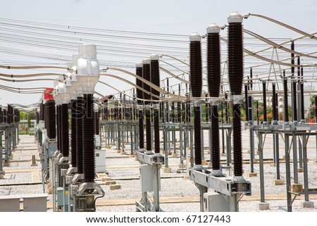 high-voltage substation on blue sky background with switch - stock photo