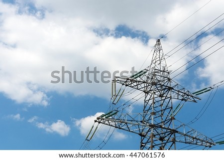 high voltage support of electricity transmissions or iron mast closeup against the cloudy sky and a blank space for the text
