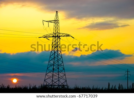 High voltage tower  on a background of the sunset - stock photo