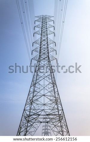 High voltage tower on blue sky background. High voltage tower. - stock photo