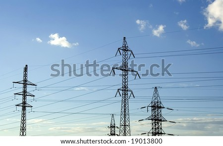 High voltage tower on sky background.