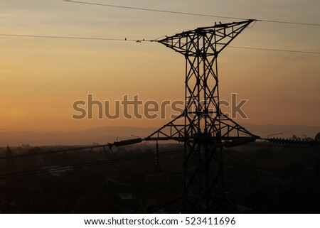 High-voltage tower sunrise sky background.