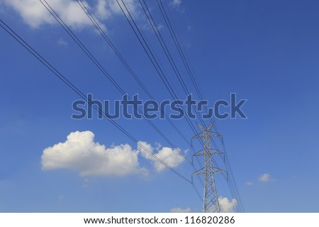High Voltage Tower with Blue Sky Background - stock photo