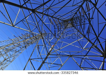 High voltage towers and power lines  - stock photo