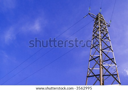 high voltage towers in the blue sky