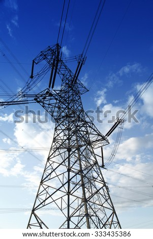 High voltage towers, under the blue sky white clouds, very beautiful