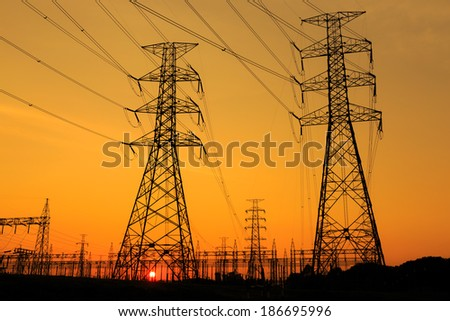 High voltage towers with the sunset background