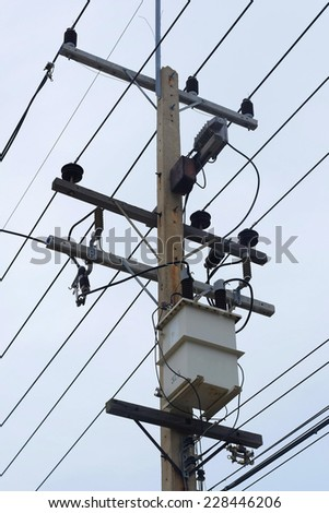 high voltage transformer  on pillar - stock photo