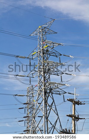 High voltage transformer with the blue sky - stock photo