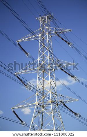 High-voltage transmission line - stock photo