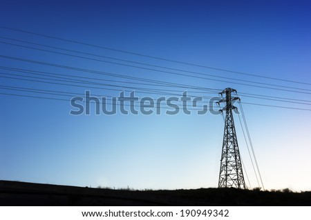 High voltage transmission tower silhouette