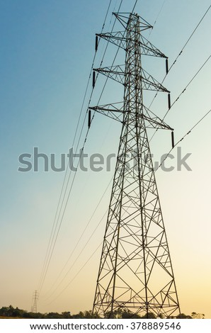 High voltage transmission towers at twilight time.