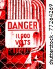 High voltage warning sign on fence - stock photo