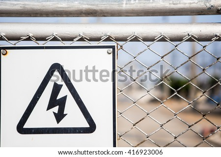 high voltage warning sign on high-voltage substation