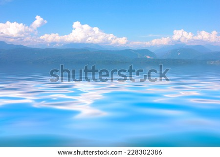 high wave in time gale on a sea and blue sky - stock photo