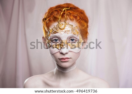 High wedding hairstyle in the Greek style. Vogue style portrait of a girl with a red white and golden bodyart on her face. Body painting project. Woman painted white and gold colors. Insight concept.