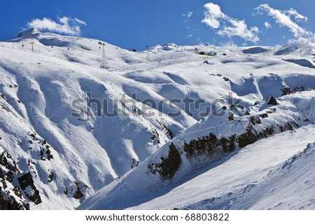 High winter mountains with blue cloudy sky - stock photo
