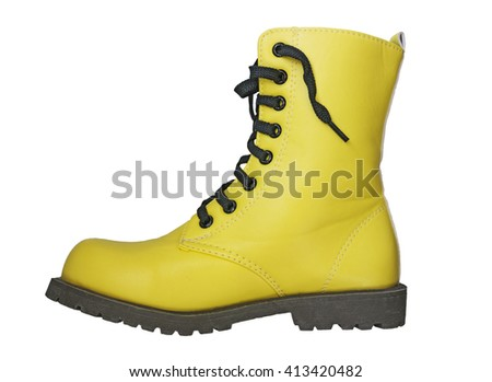High yellow boot with black laces on a white background - stock photo
