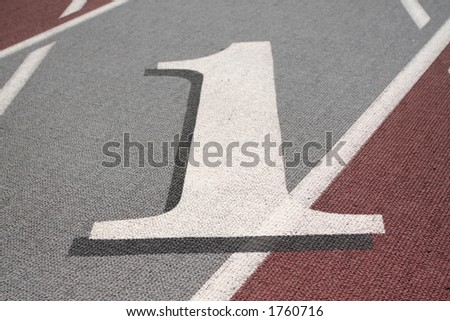 highlight on #1 lane on a race track - stock photo