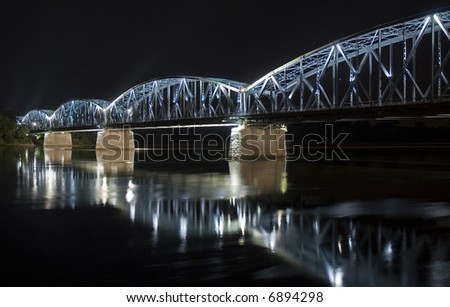 Highlighted Torun bridge at night time, Poland - stock photo