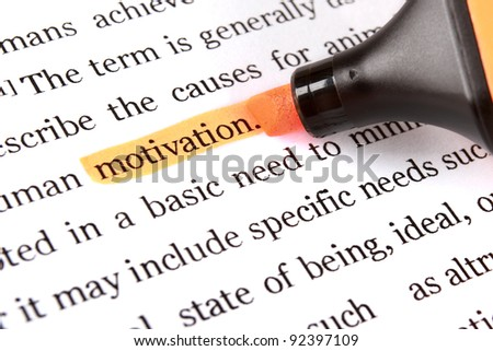 Highlighter and word motivation - concept business background - stock photo