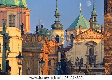 Highly decorated buildings with Baroque architecture and the full moon as seen from the Charles bridge, Prague, Czech Republic - stock photo