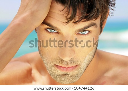 Highly detailed close-up portrait of handsome man with beautiful eyes - stock photo