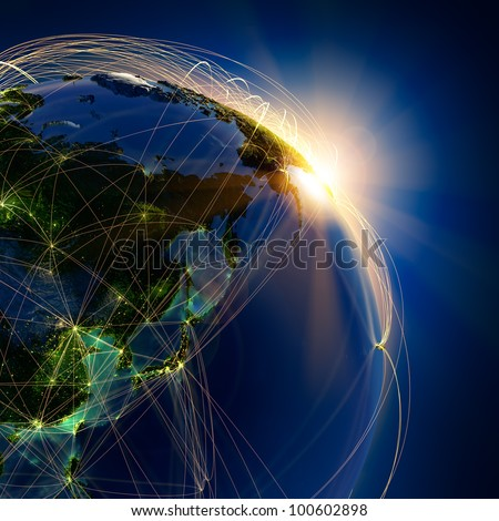 Highly detailed planet Earth at night, lit by the rising sun, illuminated by light of cities. Earth is surrounded by a luminous network, representing the major air routes based on real data