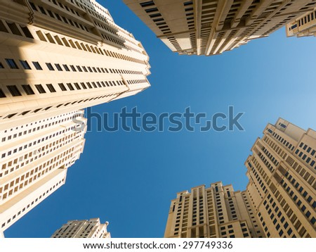 Highrise residential buildings from a frog's perspective on The Walk in the Marina district of Dubai, United Arab Emirates - stock photo