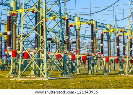 hight voltage tower in rural landscape with blue sky - stock photo