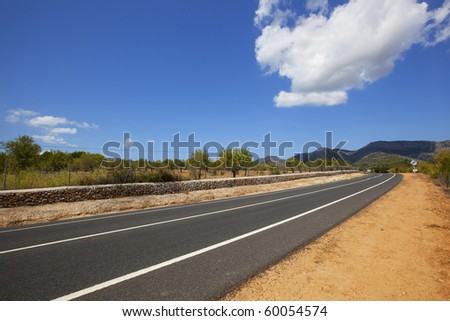 highway across non-urban landscape - stock photo