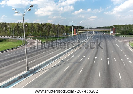 Highway almost without cars - stock photo