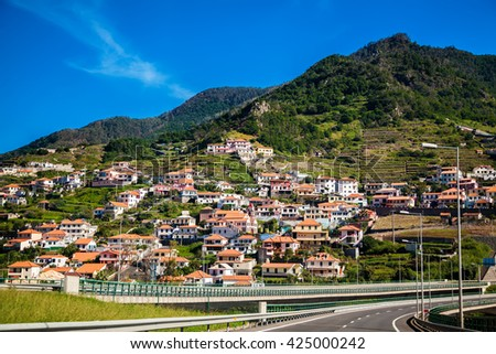 highway along the small village in Madeira island, Portugal - stock photo