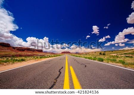 Highway 163, an endless road, naer Agathla Peak, Arizona, USA - stock photo