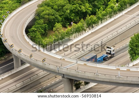 highway and freight train - stock photo