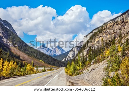 Highway and magnificent mountains in Banff National Park. Canada, Alberta, Rocky Mountains - stock photo