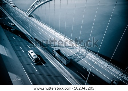 highway and modern bridge of a city,blue toned.