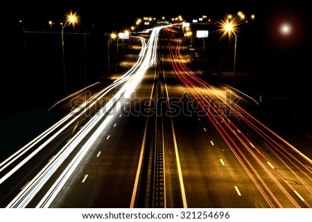 Highway at night in the motion - stock photo