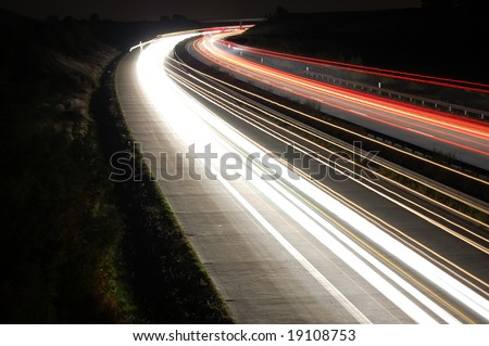 highway at night with car traffic and lights - stock photo
