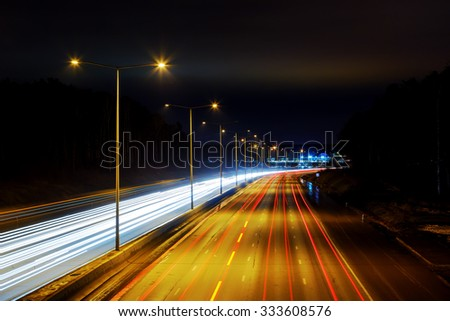 Highway at night with the lights from cars - stock photo