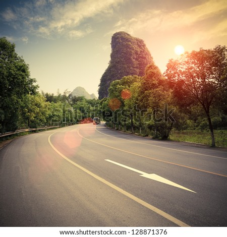 highway at sunset in guilin,China - stock photo