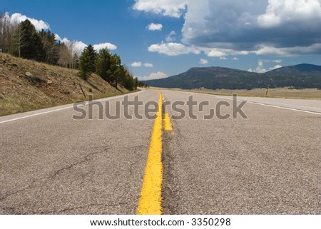 highway between the mountains and forests