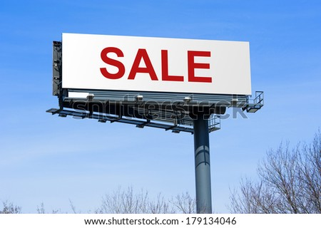 Highway billboard sign with the word sale on it. - stock photo