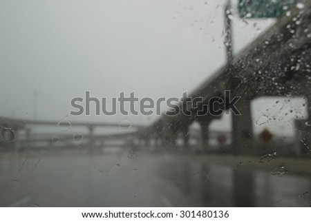 Highway Driving on a Gray Rainy Dreary Day - stock photo