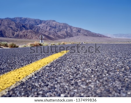 Highway in Death Valley - stock photo