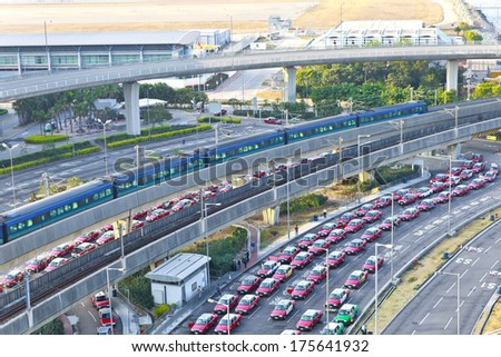 Highway in modern city with moving train - stock photo